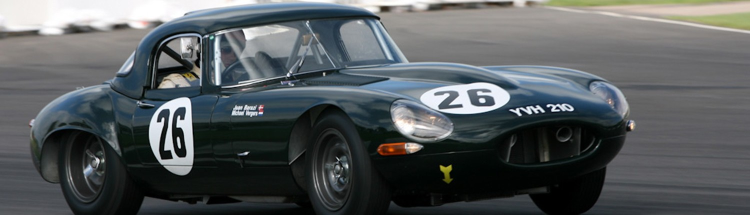 Jaguar Lightweight e type joining the start finish at Goodwood in 2009