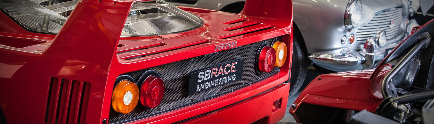 Two Ferrari F40's and DB4 Aston Martin in the workshop at SB